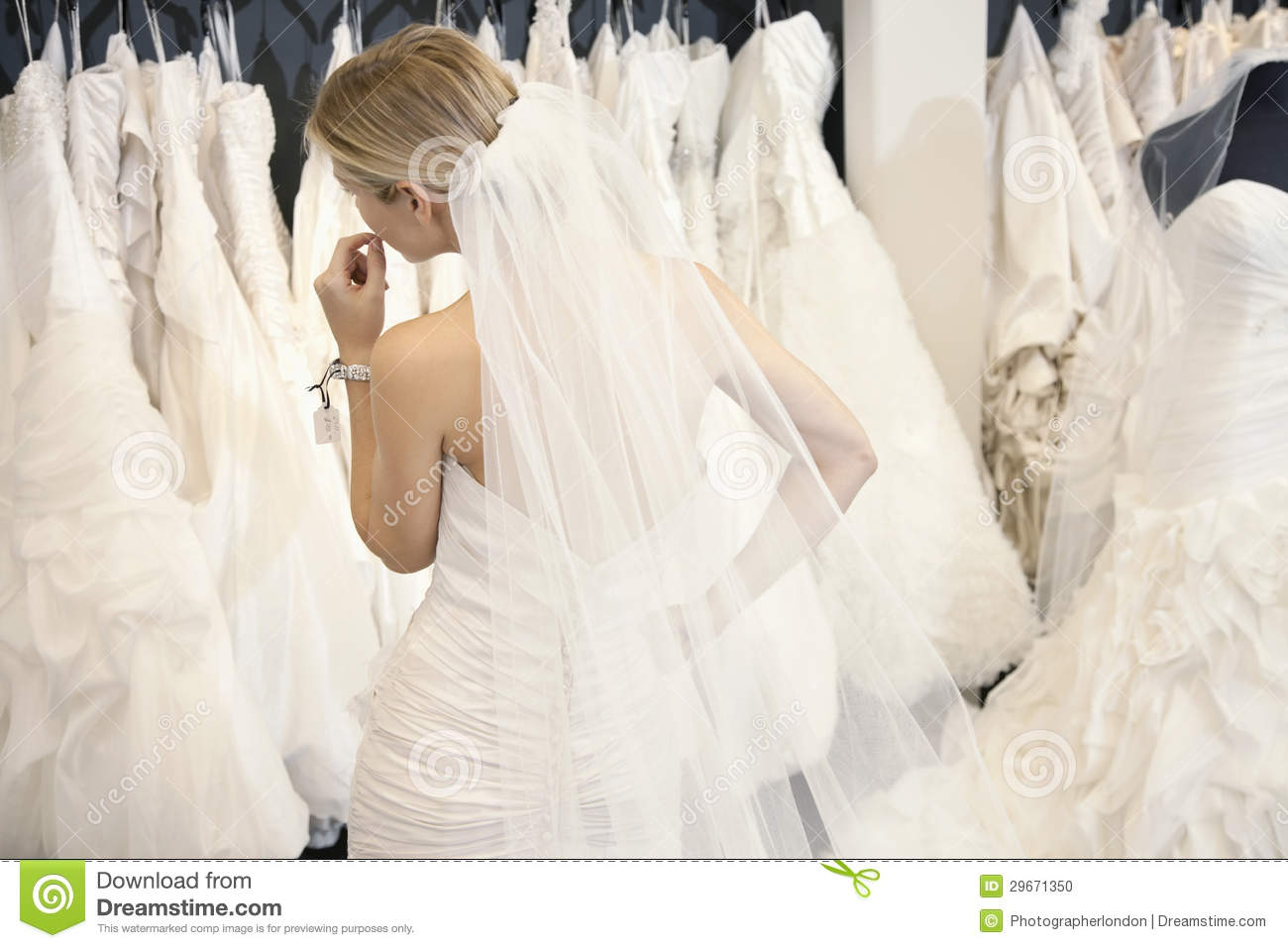 Back view of a young woman in wedding dress looking at for How to display a wedding dress