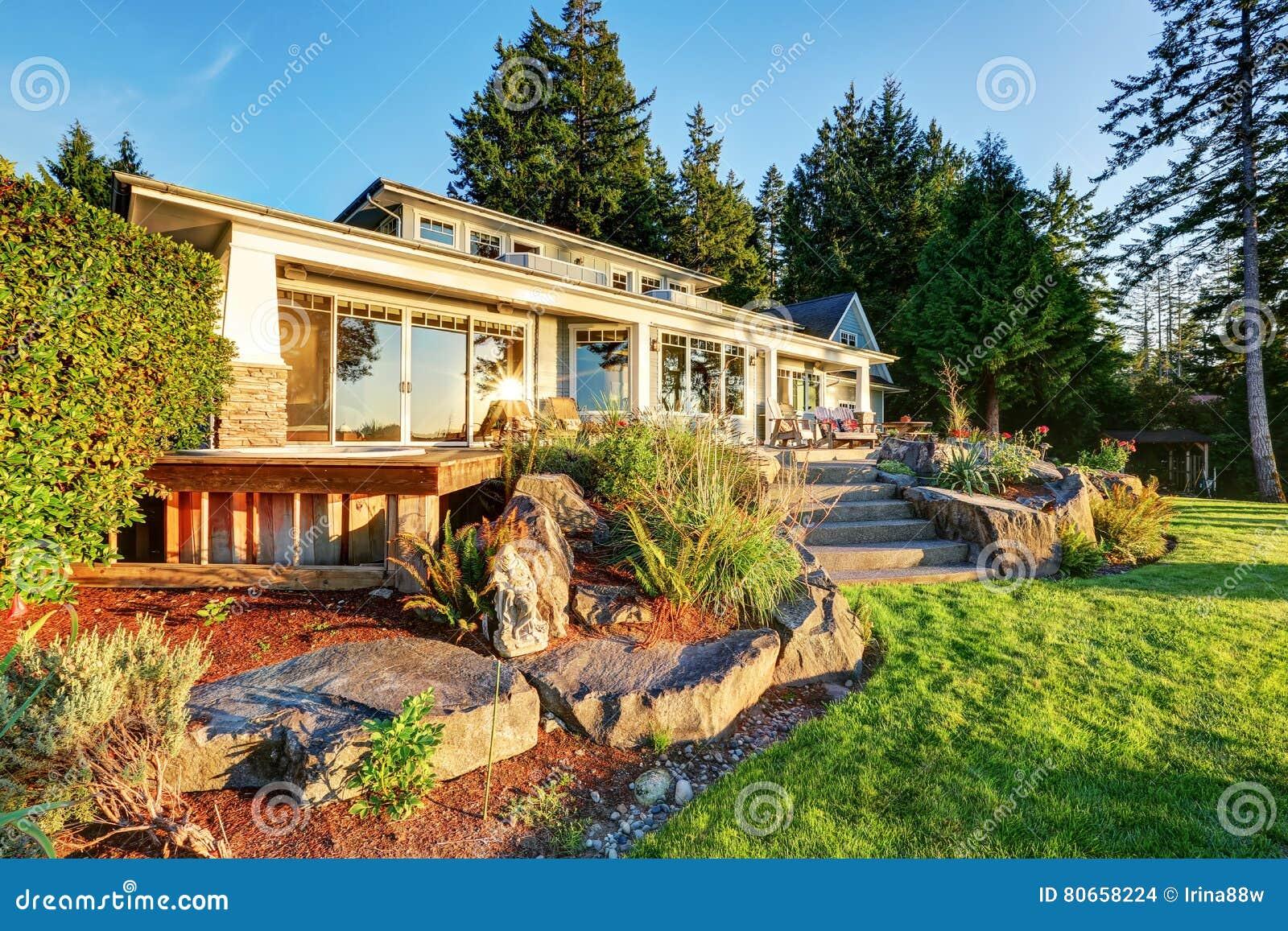 Back Yard Of Waterfront House At Sunset Stock Photo ... on Waterfront Backyard Ideas id=83243