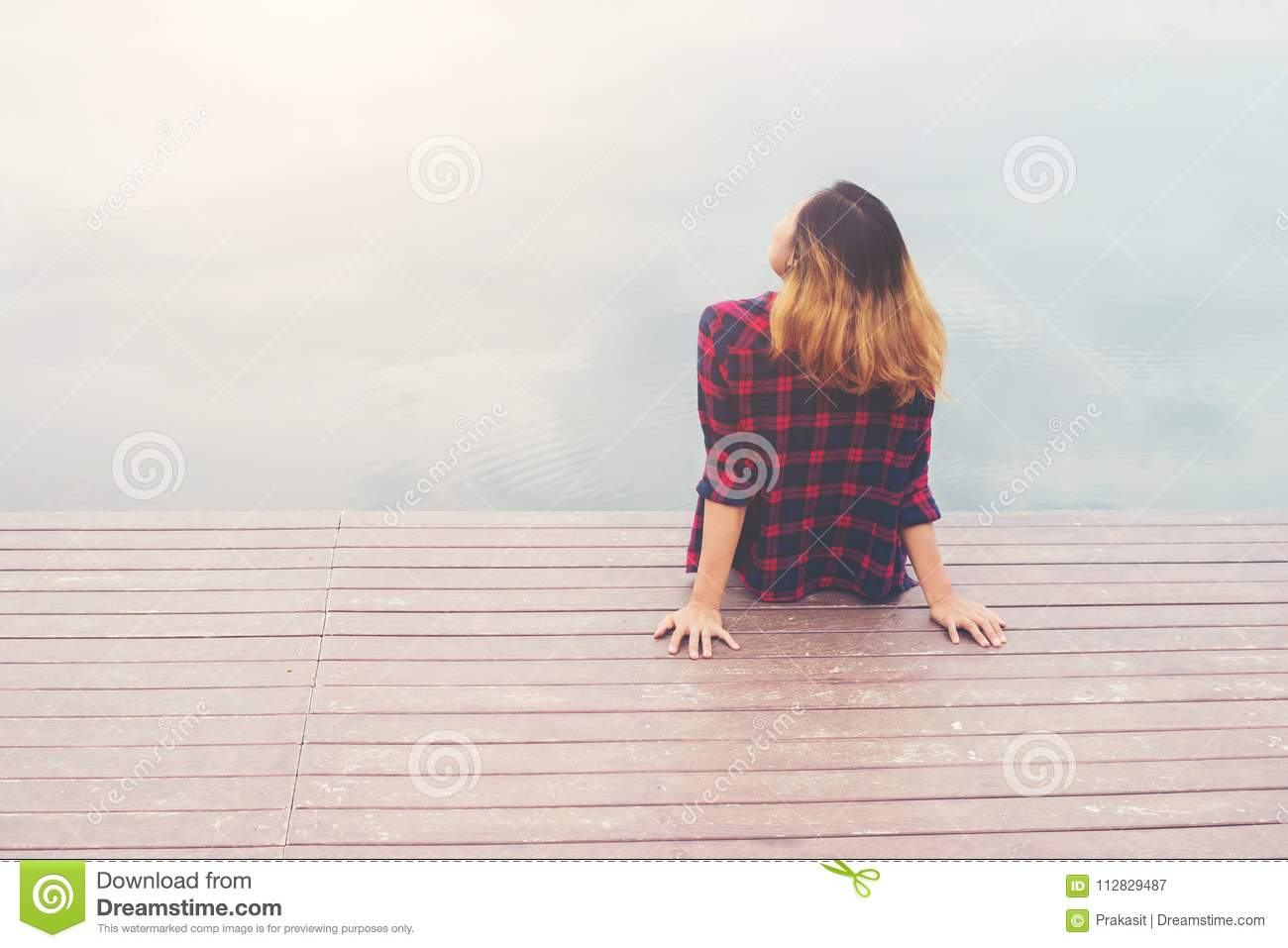 18337e420 Back Of Young Hipster Woman Sitting At The Pier,relaxing Enjoy W ...