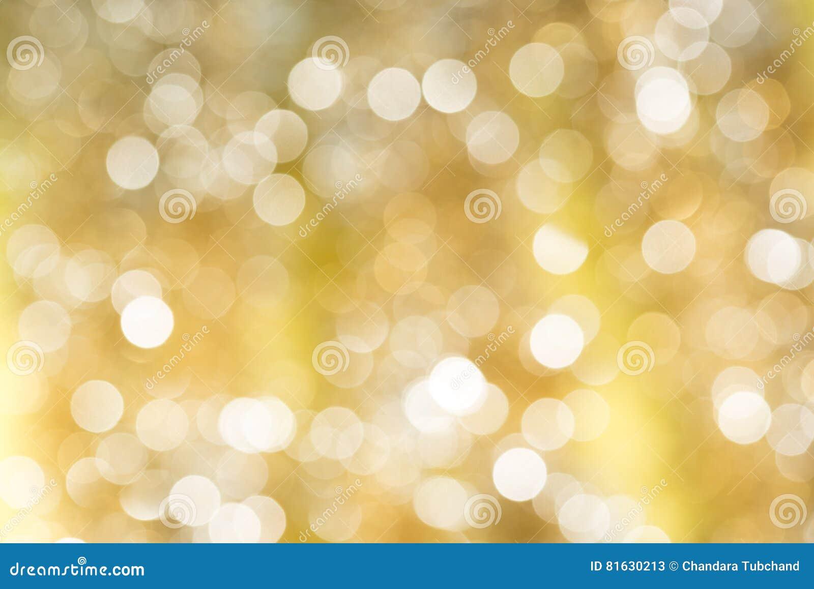 Backgound abstracto borroso oro de la luz del bokeh