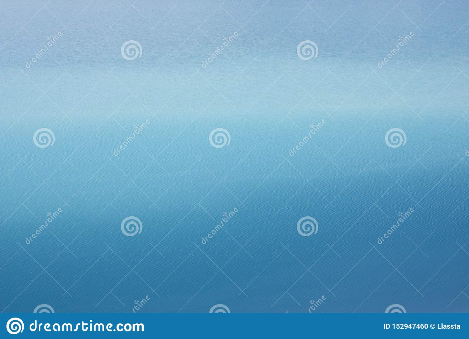 Background azure blue expanse of the sea with small ripples on the water