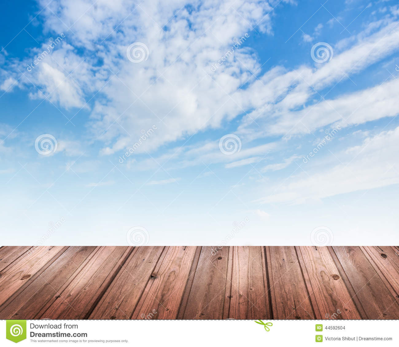 Background with blue sky and wooden table stock photo