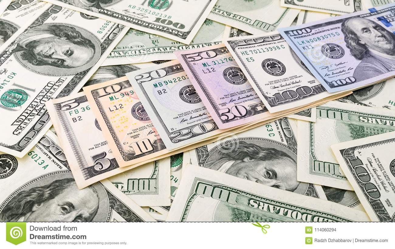 Background closeup series American money 5,10, 20, 50, new 100 dollar bill. Pile US banknote