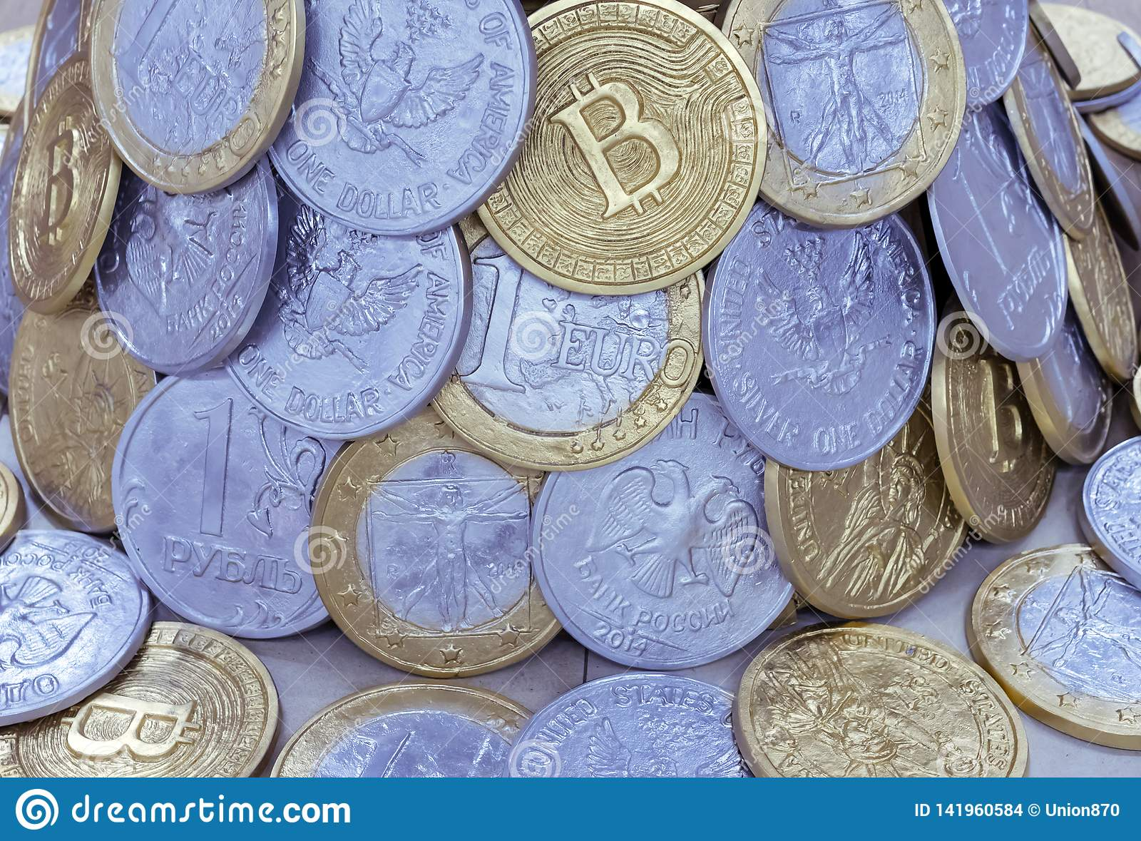 Background from coins of different countries and bitcoins