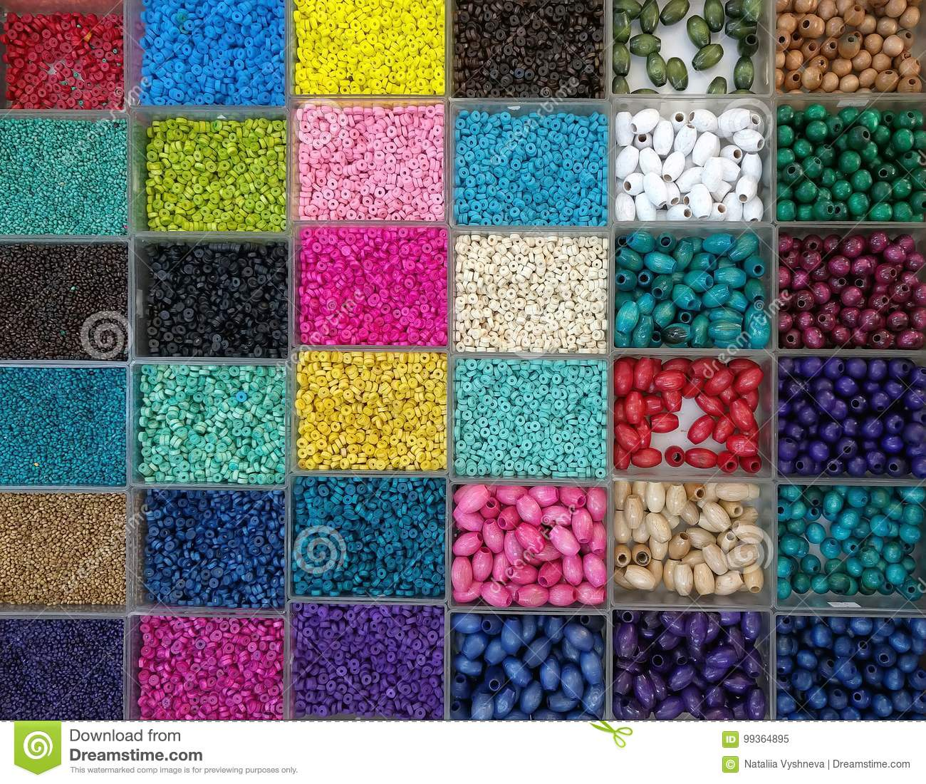 Background of colorful bright beads in boxes, set for needlework