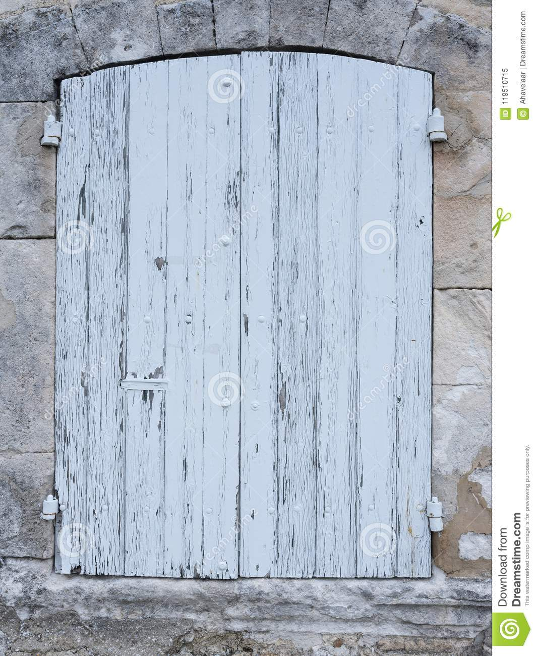 Light Grey Or White Old Shutters In Limestone Wall Of French