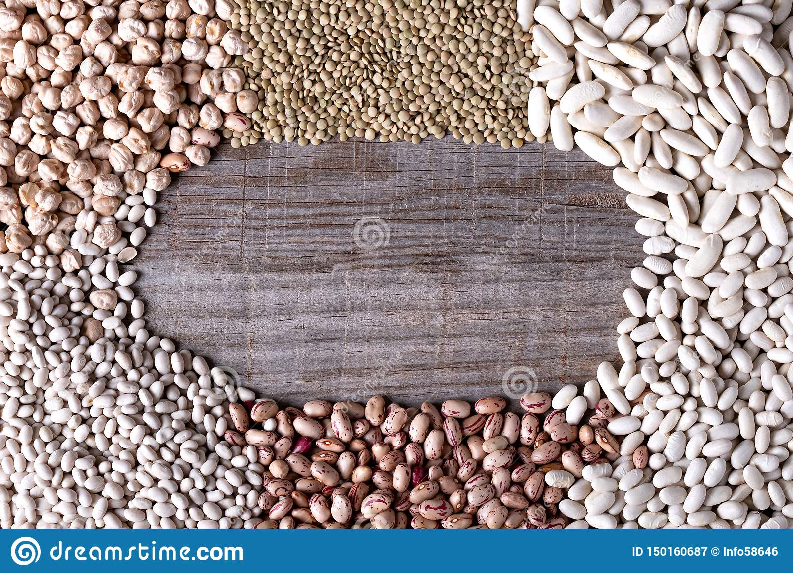 Background of distant legumes forming a circle on wooden board