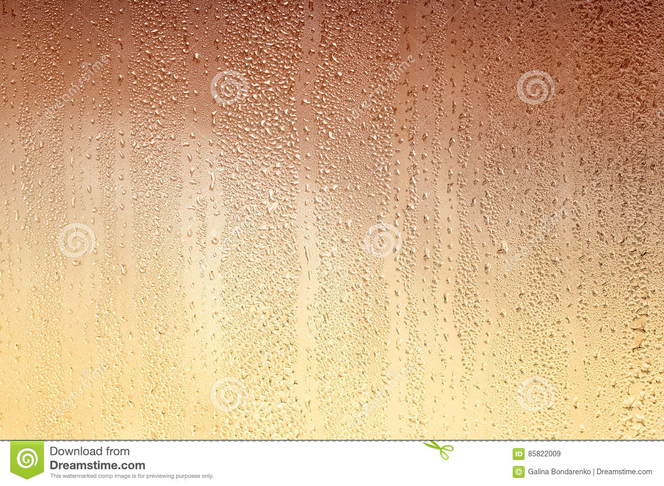 Background with drops on glass, stained yellow-brown.
