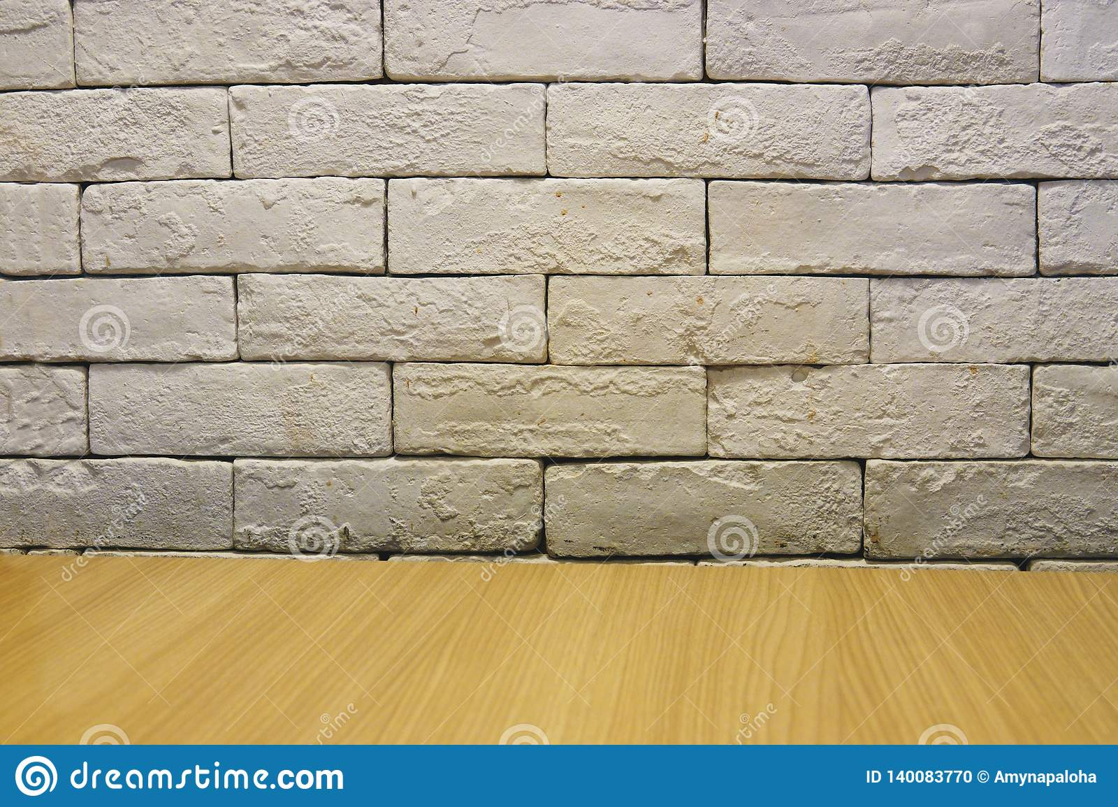 Background of empty white brick old wall, wooden floor