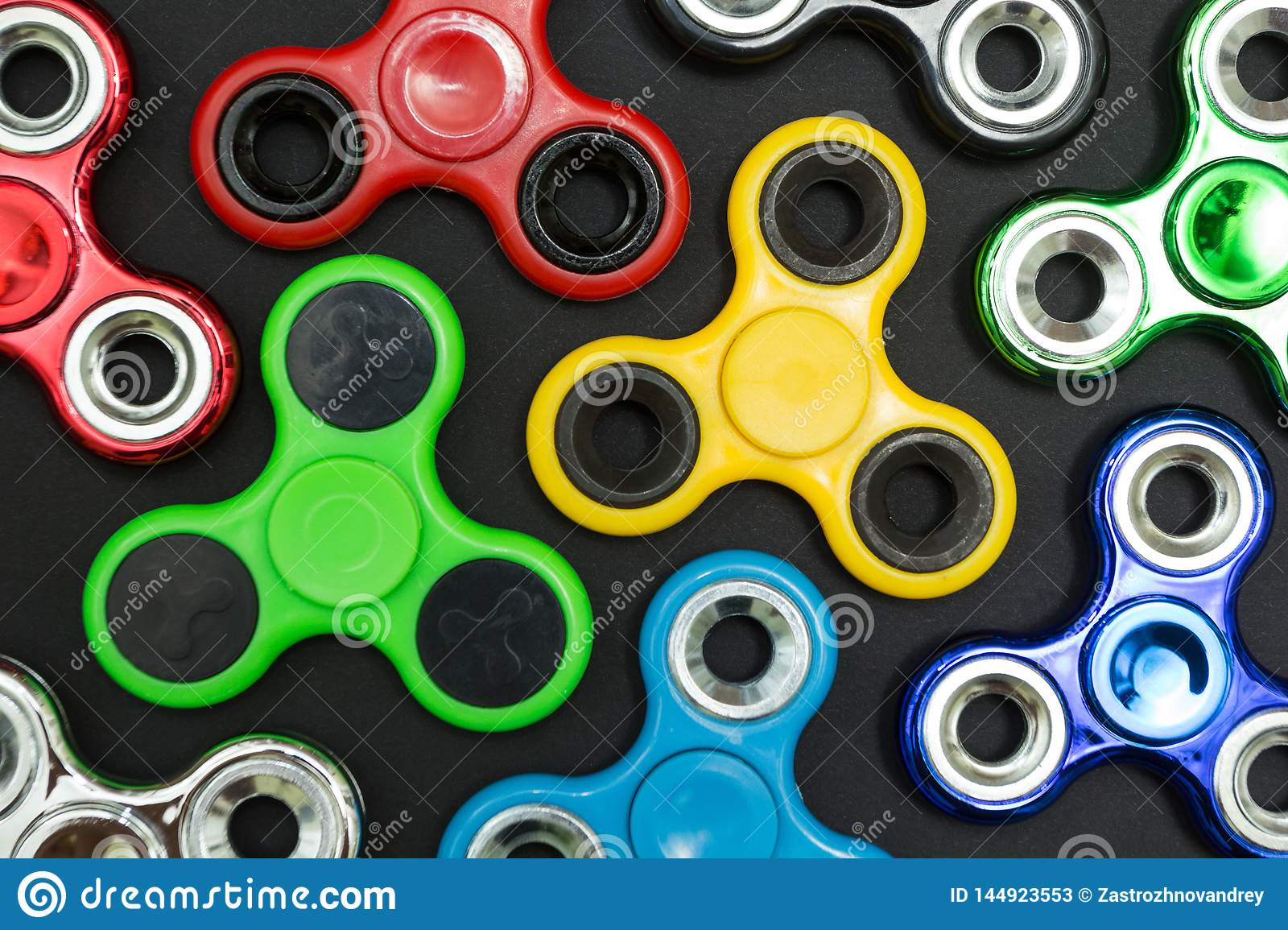 Background of fidget finger spinner stress, anxiety relief toy