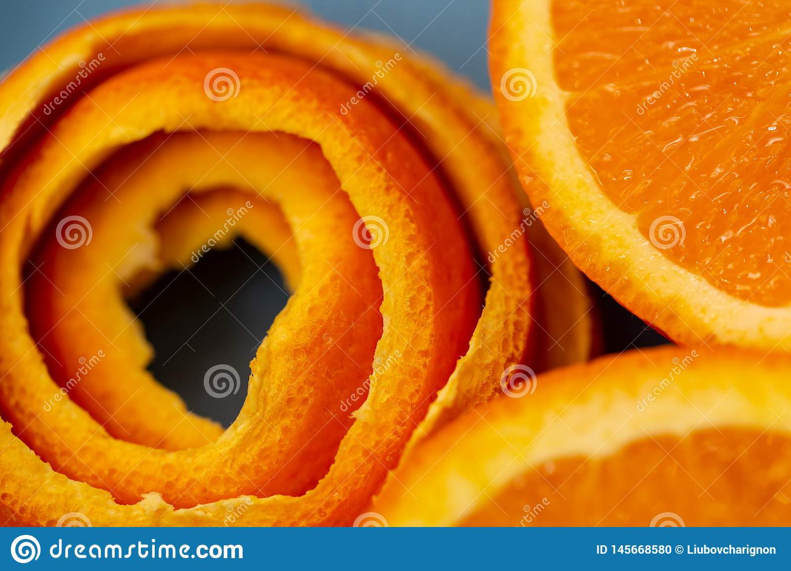 Background with fruits citrus an orange and a peel or pieces of tangerine. Macro image