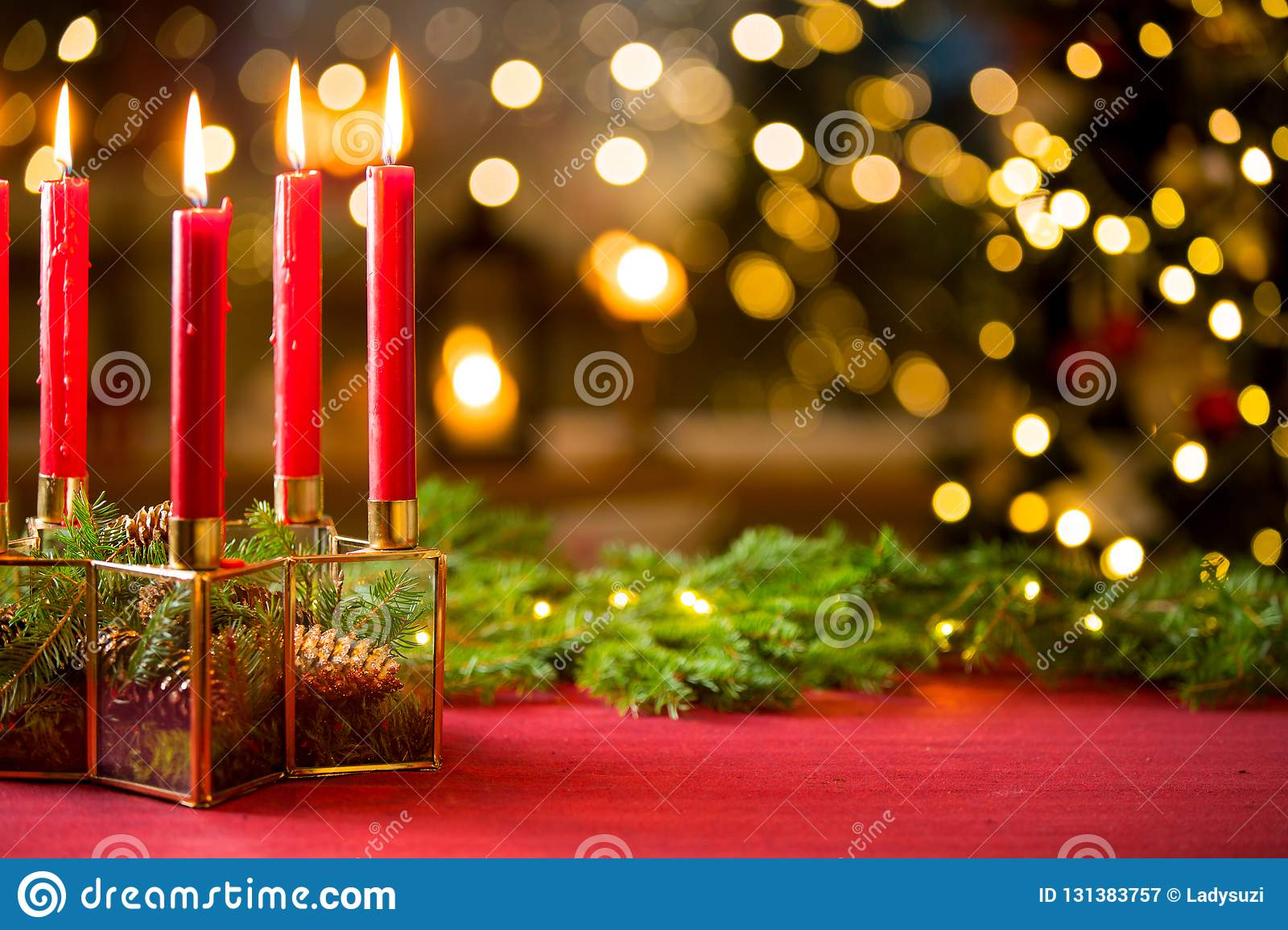 Background of glass and gold candleholder