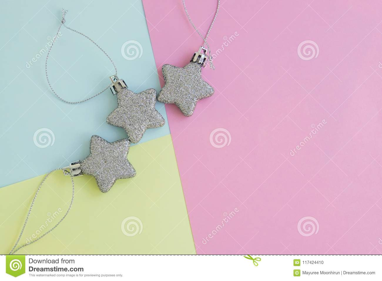 Background of glitter star on blue, pink and yellow colour pastel sheet