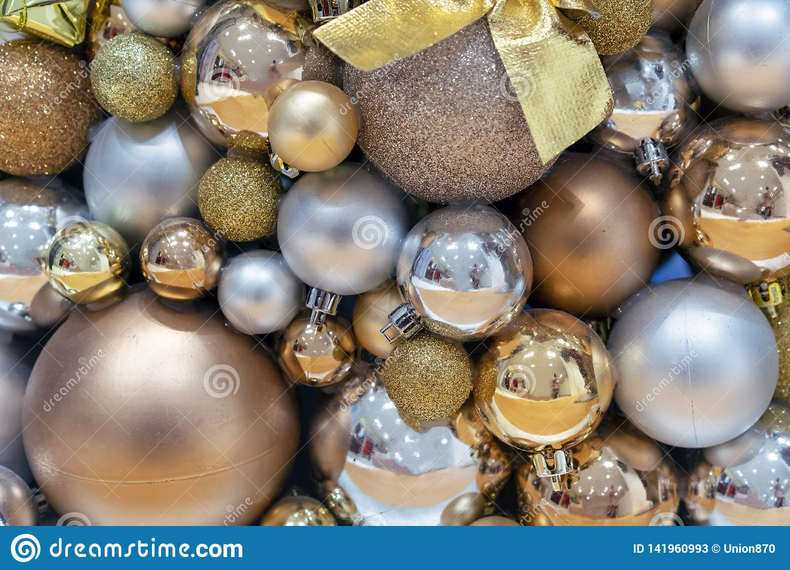 Background of gold and silver Christmas balls. Decorations New Year, Christmas