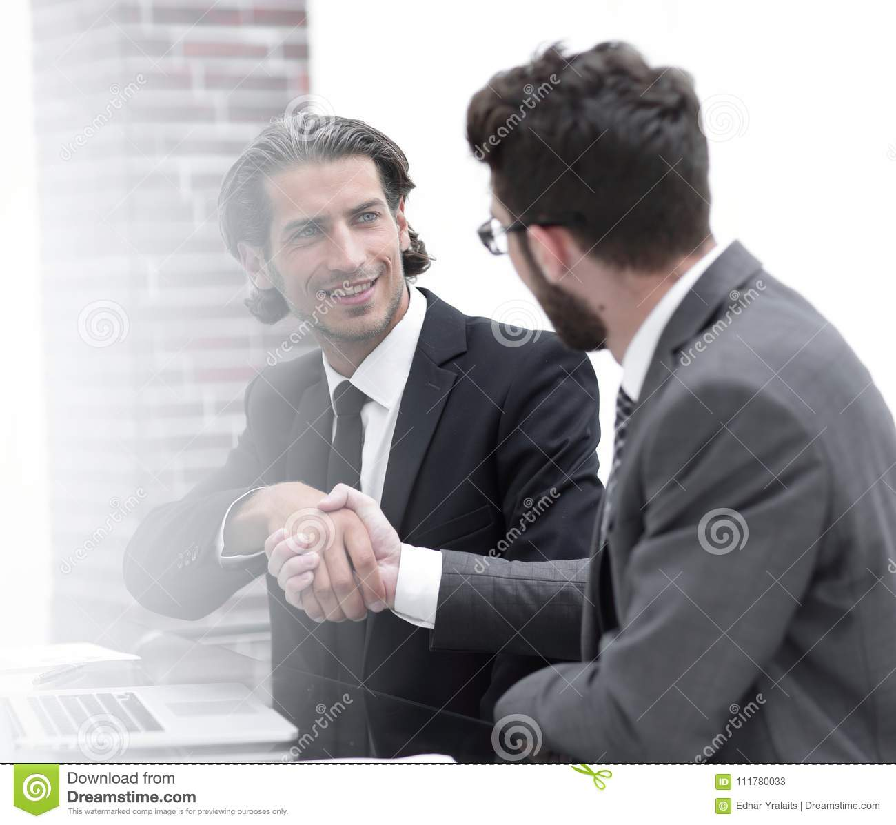 Background image .colleagues shaking hands