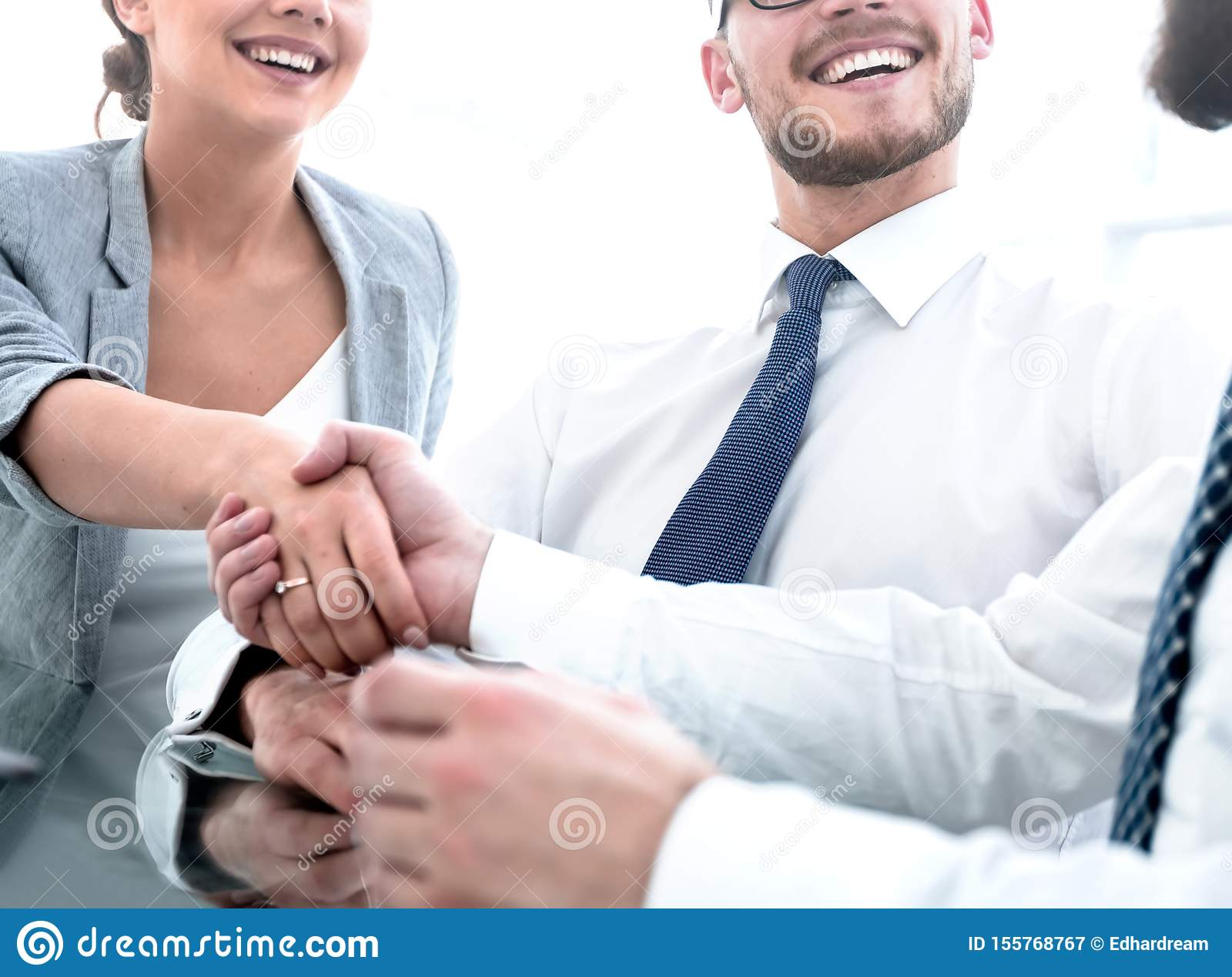 Background image.handshakes colleagues at the Desk