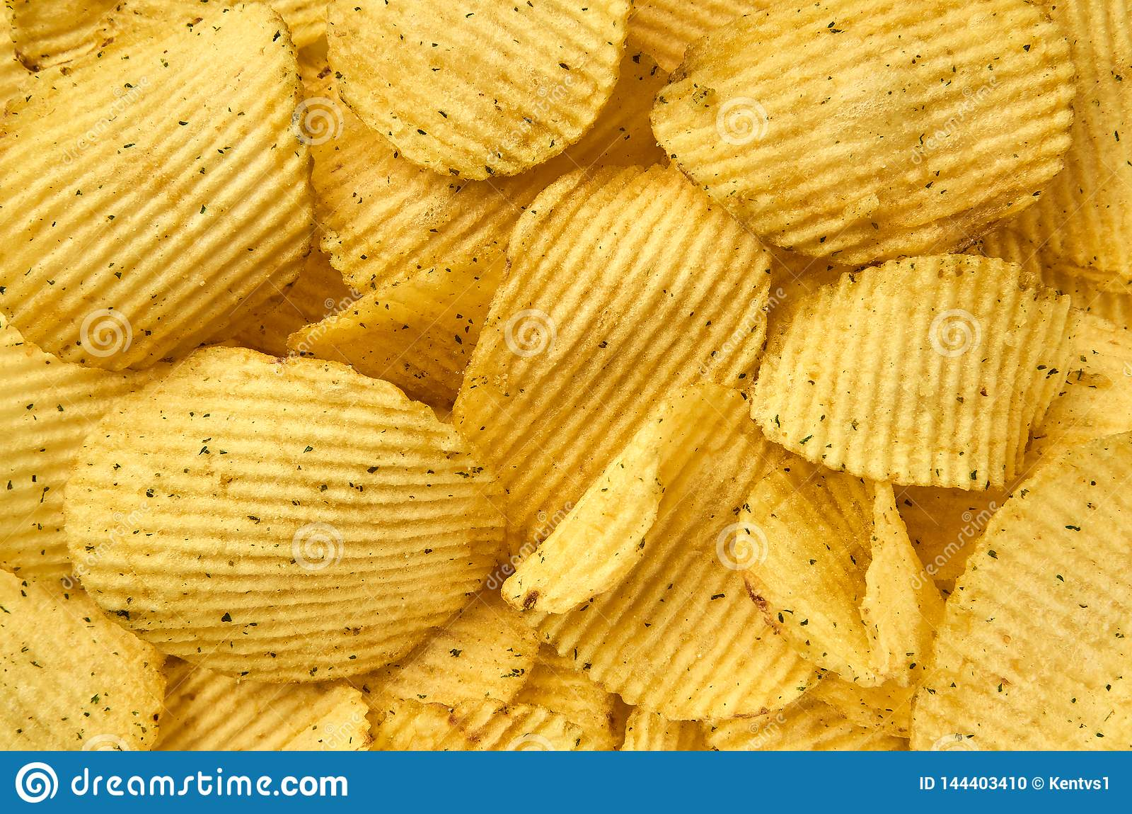 Background of juicy corrugated potato chips close-up