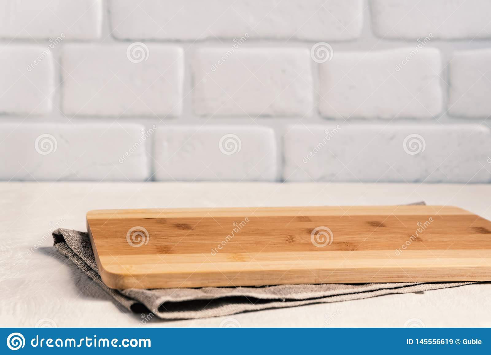 Background Kitchen With Cutting Board On White Wooden Table ...