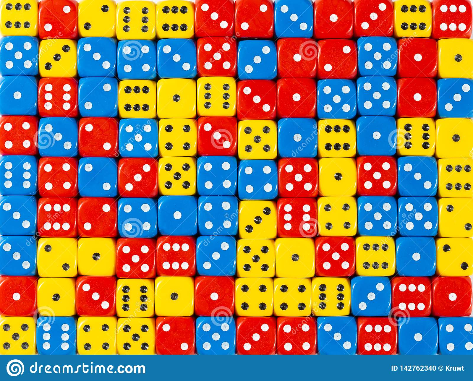 Background pattern of random ordered red, blue and yellow dices