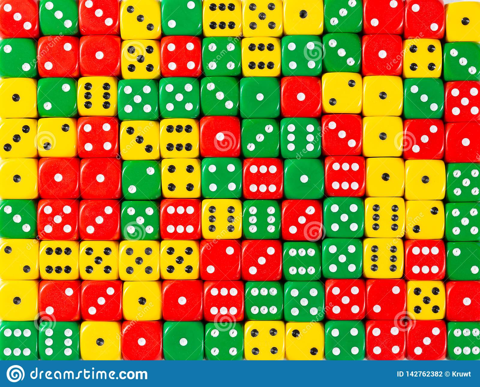 Background pattern of random ordered red, green and yellow dices