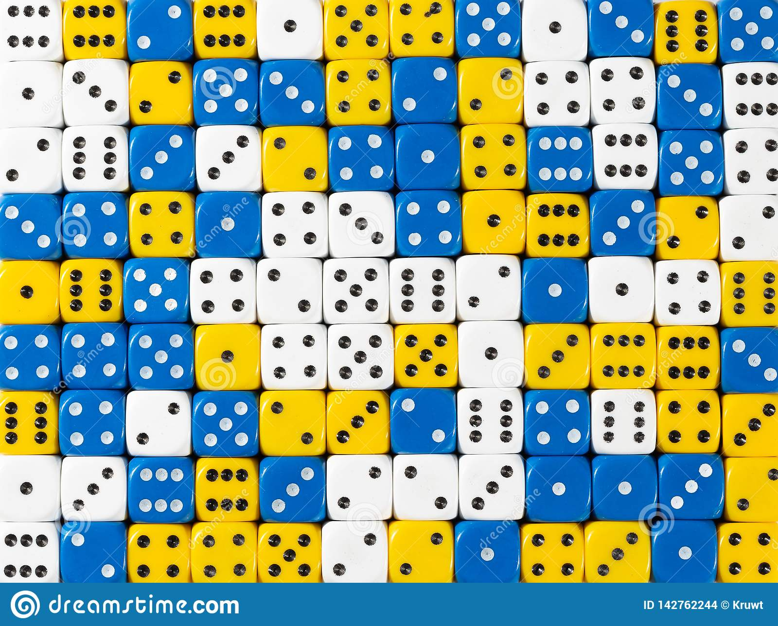 Background pattern of random ordered white, blue and yellow dices