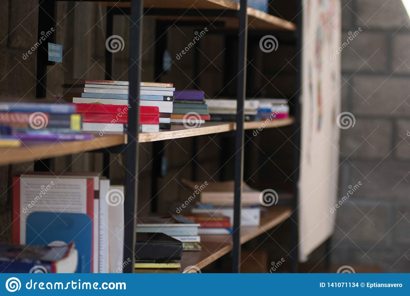 Side View With Copy Space Pile Of Books In Wooden Rack At A ...