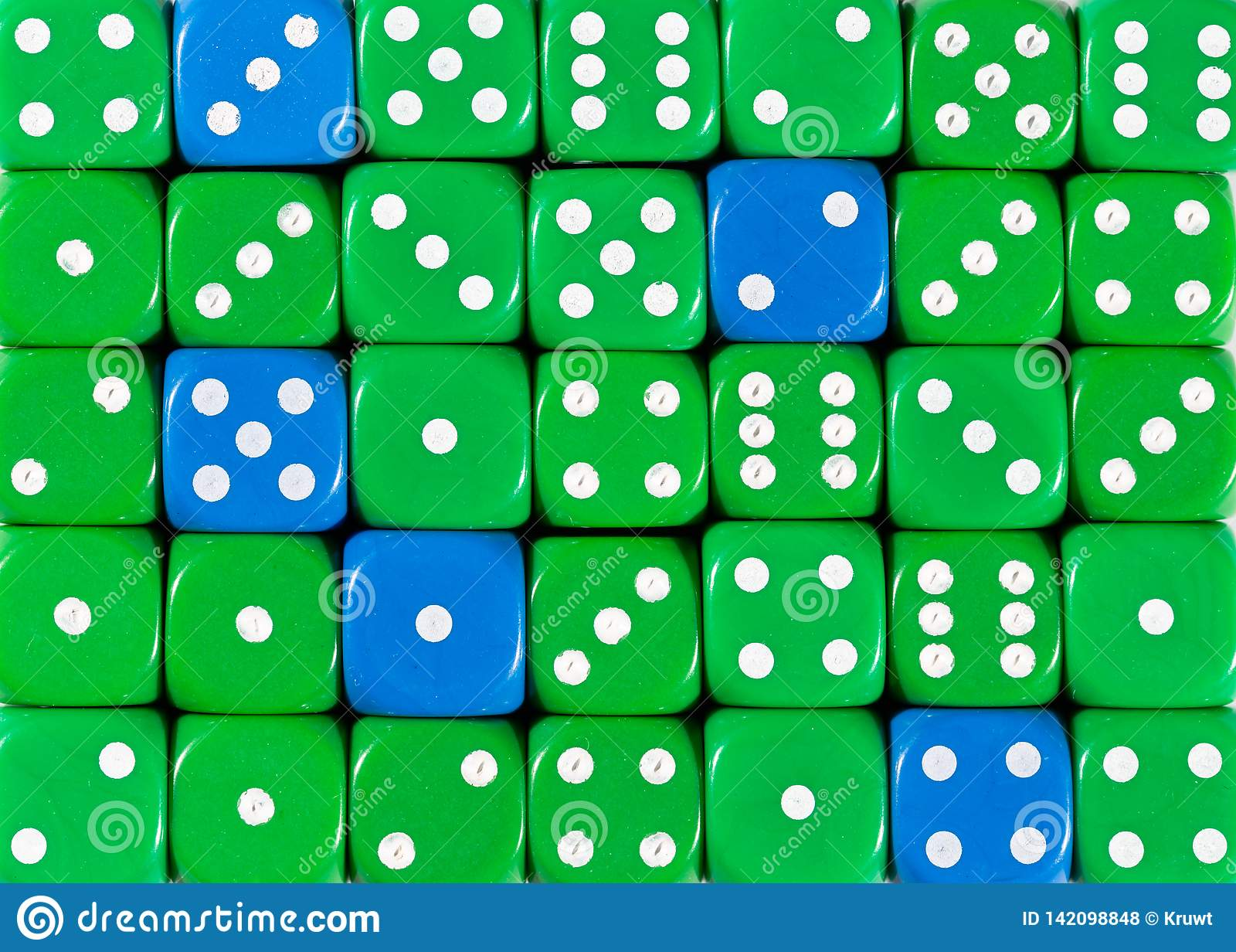 Background of random ordered green dices with five blue cubes