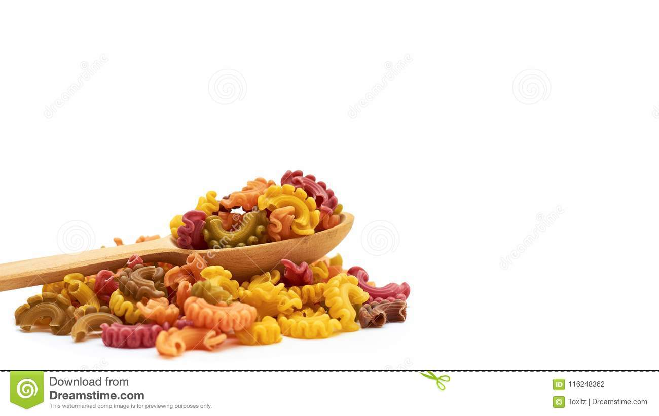 Background Of Raw Colored Macaroni In The Wooden Spoon Isolated On