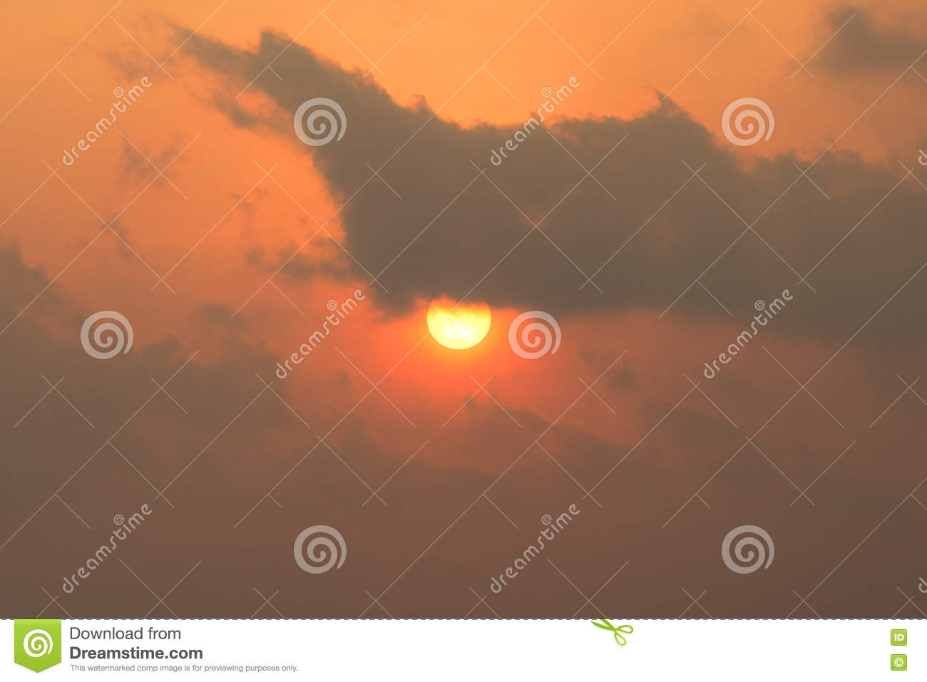 Background of rising sun behind cloudy.