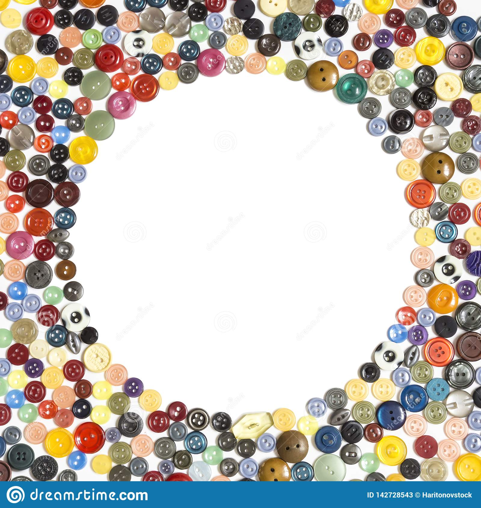 Background with round frame - multicolored buttons on a white surface. Background with round frame - multicolored plain buttons chaotically arranged on a white stock photos
