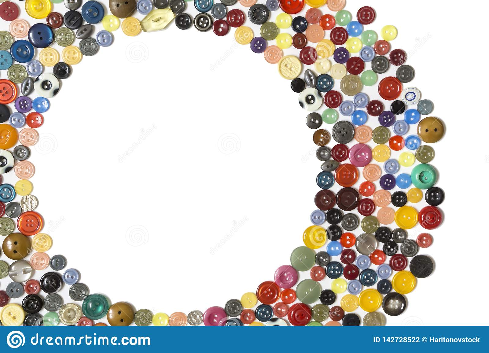 Background with round frame - multicolored buttons on a white surface. Semifinished for background with round frame - multicolored plain buttons chaotically stock photography