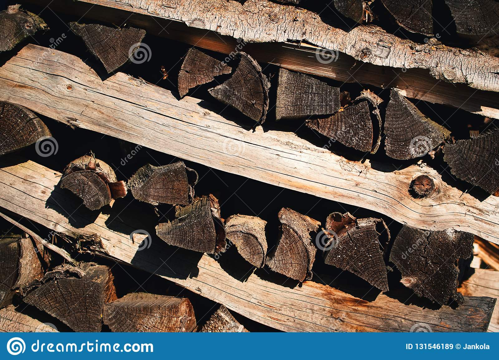 Background or texture detail pile of wood for heating in winter royalty free stock images