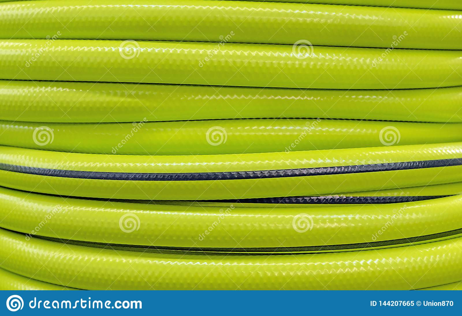 Background and texture of a garden hose. Bright garden hose