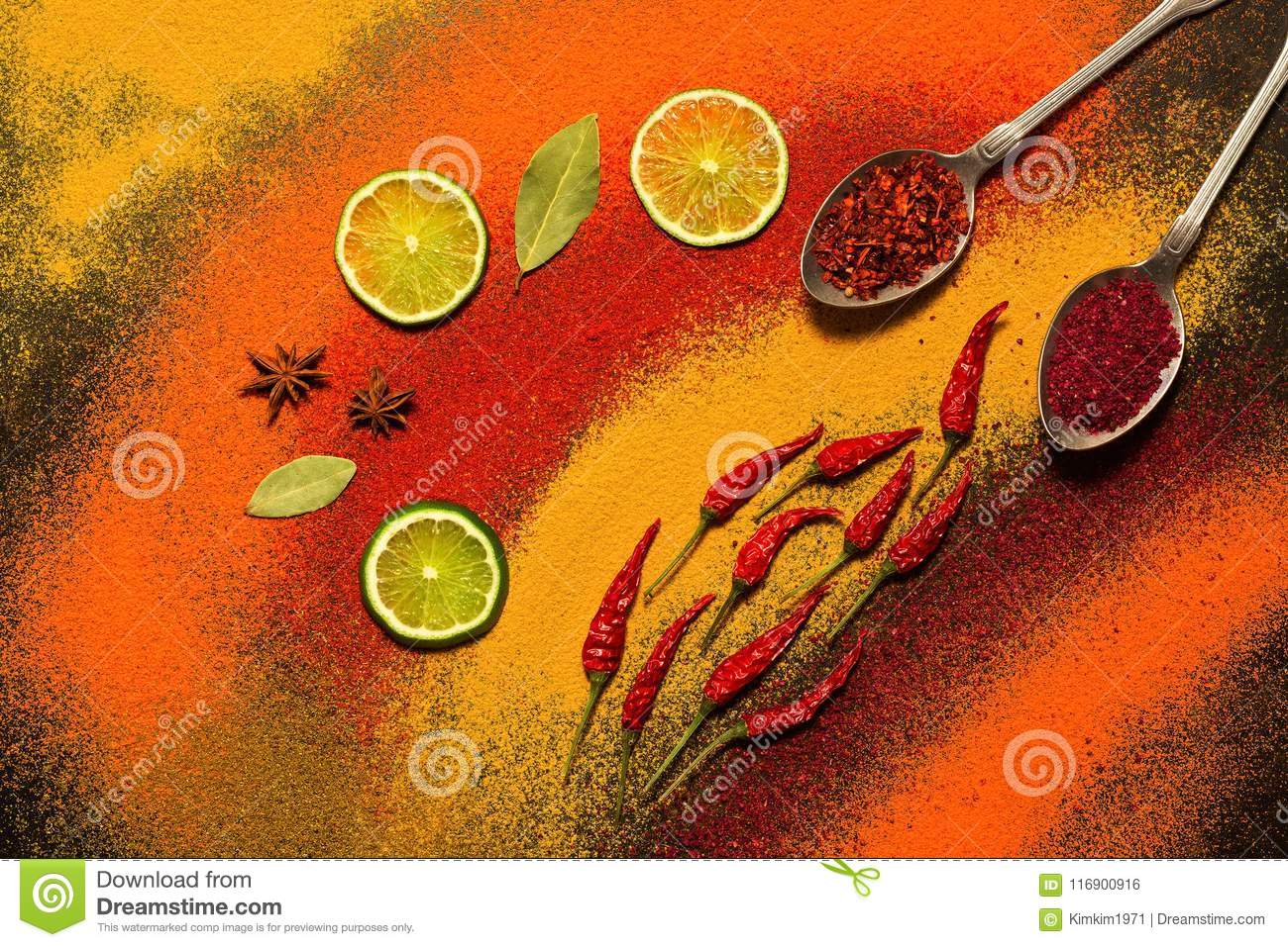 Background of various spices, red, orange, yellow. Paprika, turmeric, anise, bay leaf, chilli pepper, lime, saffron. Assorted spic