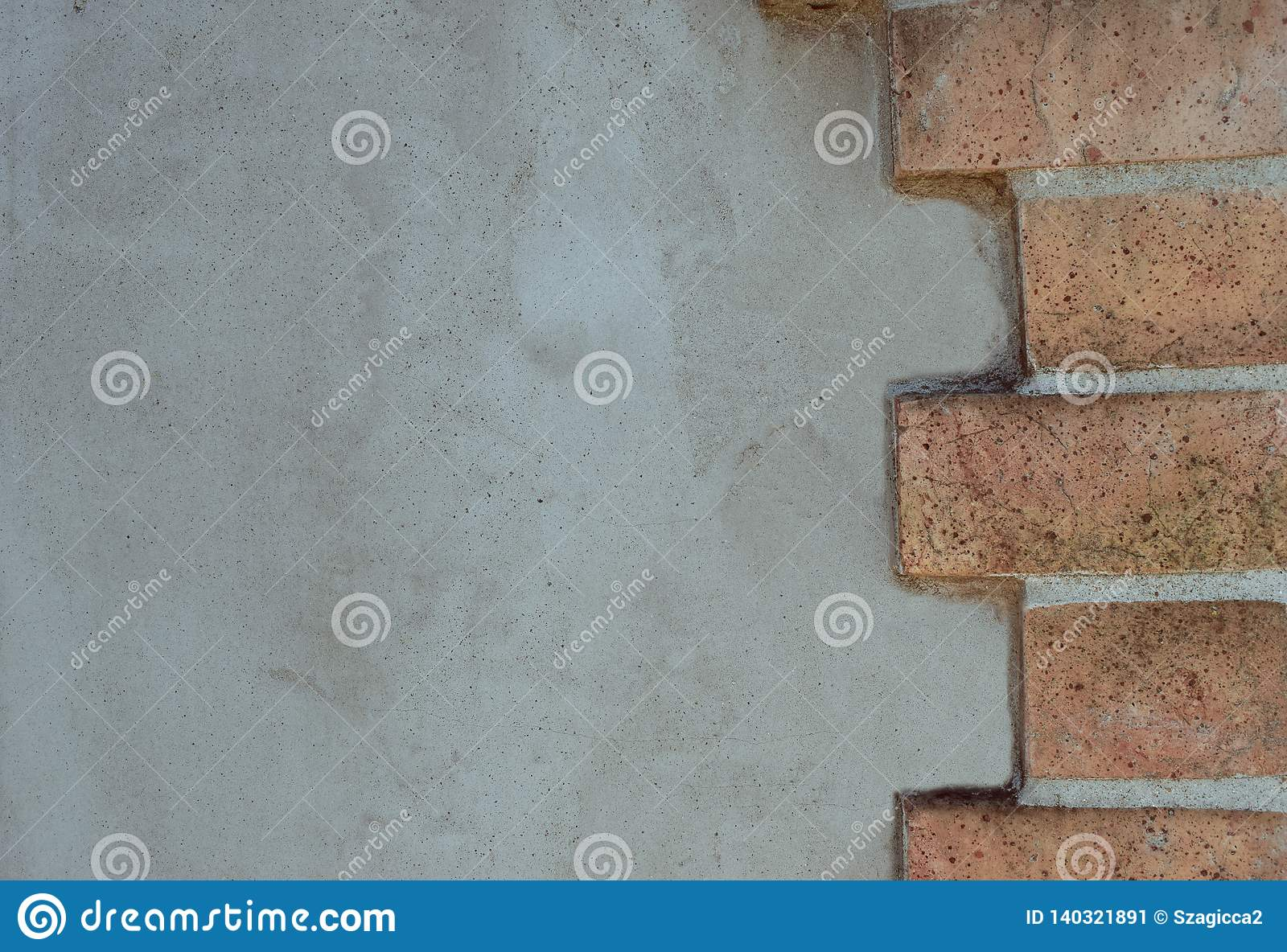 Background of a wall of brick and stone cemented with concret.