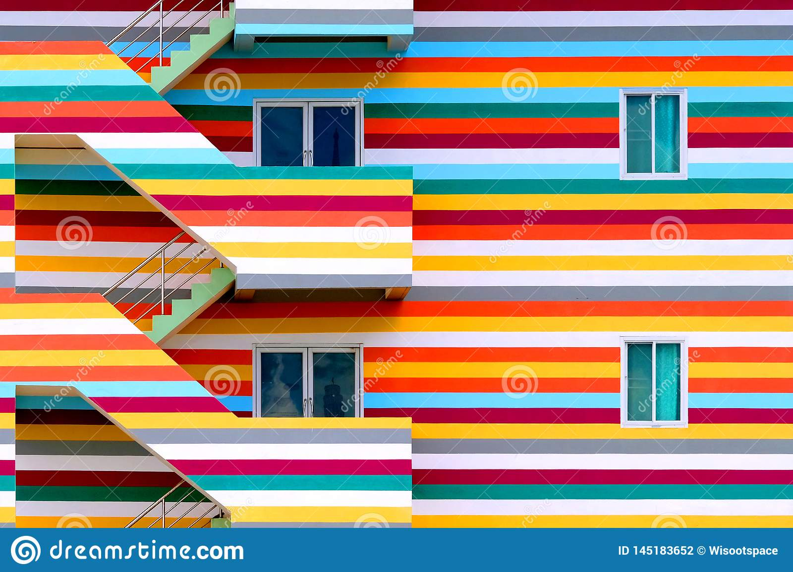 Background walls of bright colored buildings with fire escape / bright colored buildings