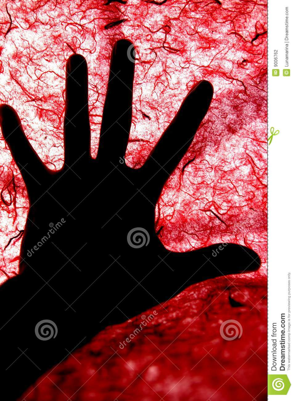 Backlight of human hand over red textured surface