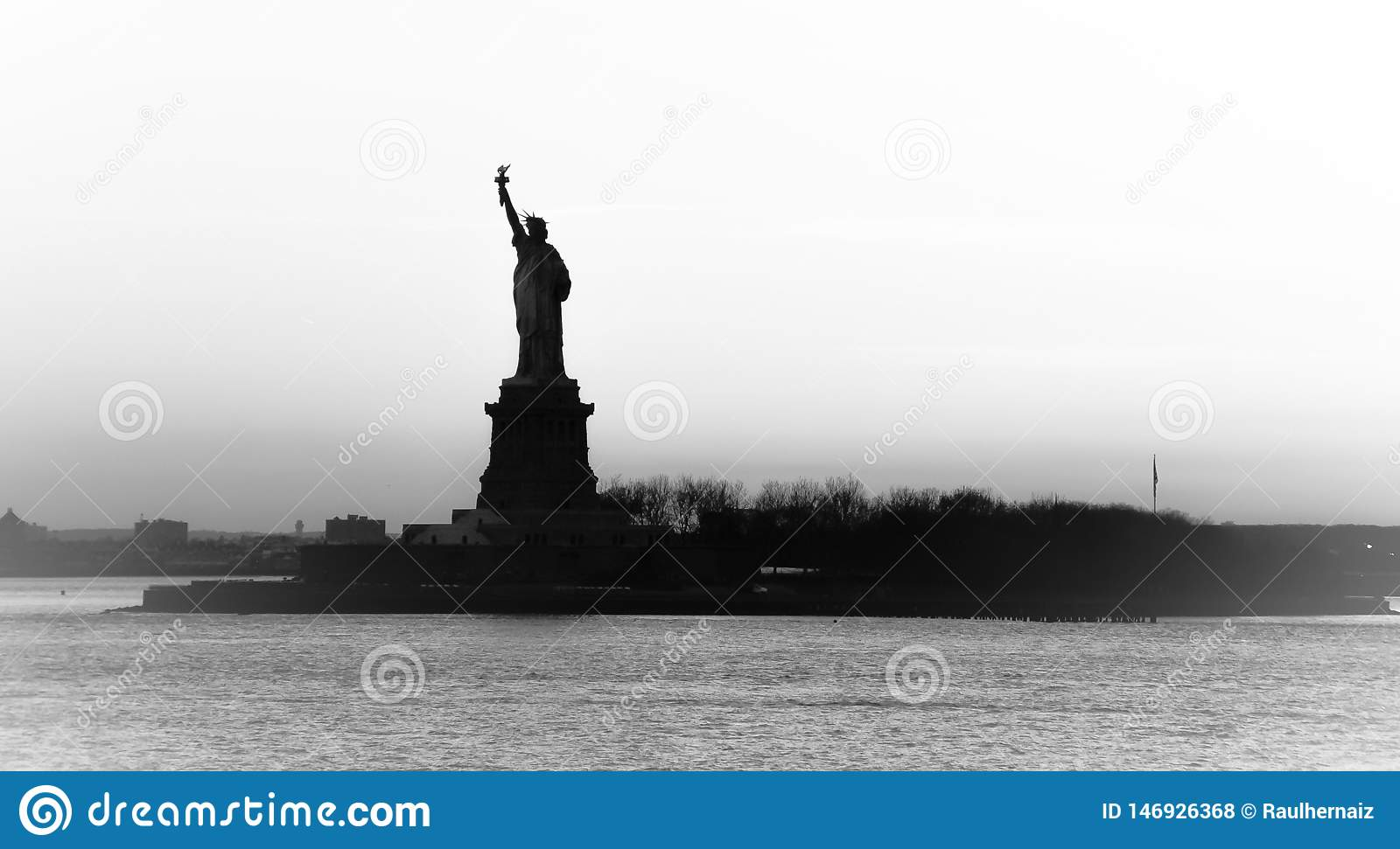 Backlight view of American symbol Statue of Liberty silhouette in New York, USA. High key black and white image