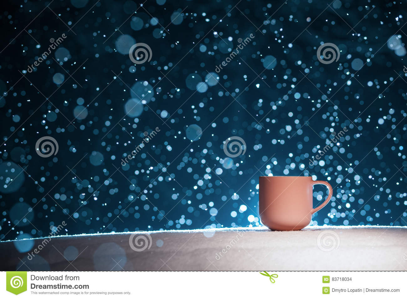 Backlighted Cup Of Hot Coffee On Night Snowy Background; Stock Photo