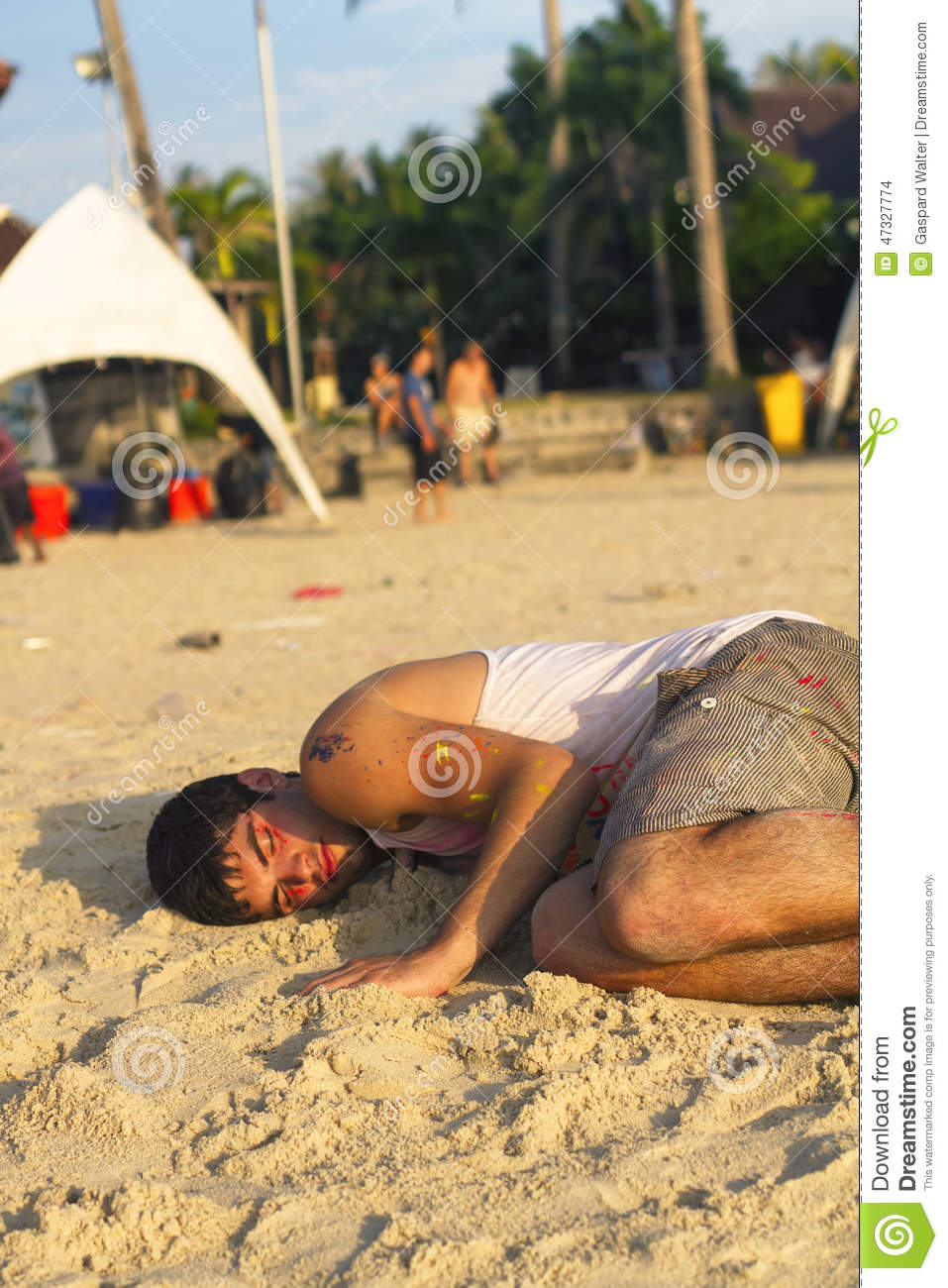 backpacker sleeping on the beach after the full moon party  thai editorial stock image