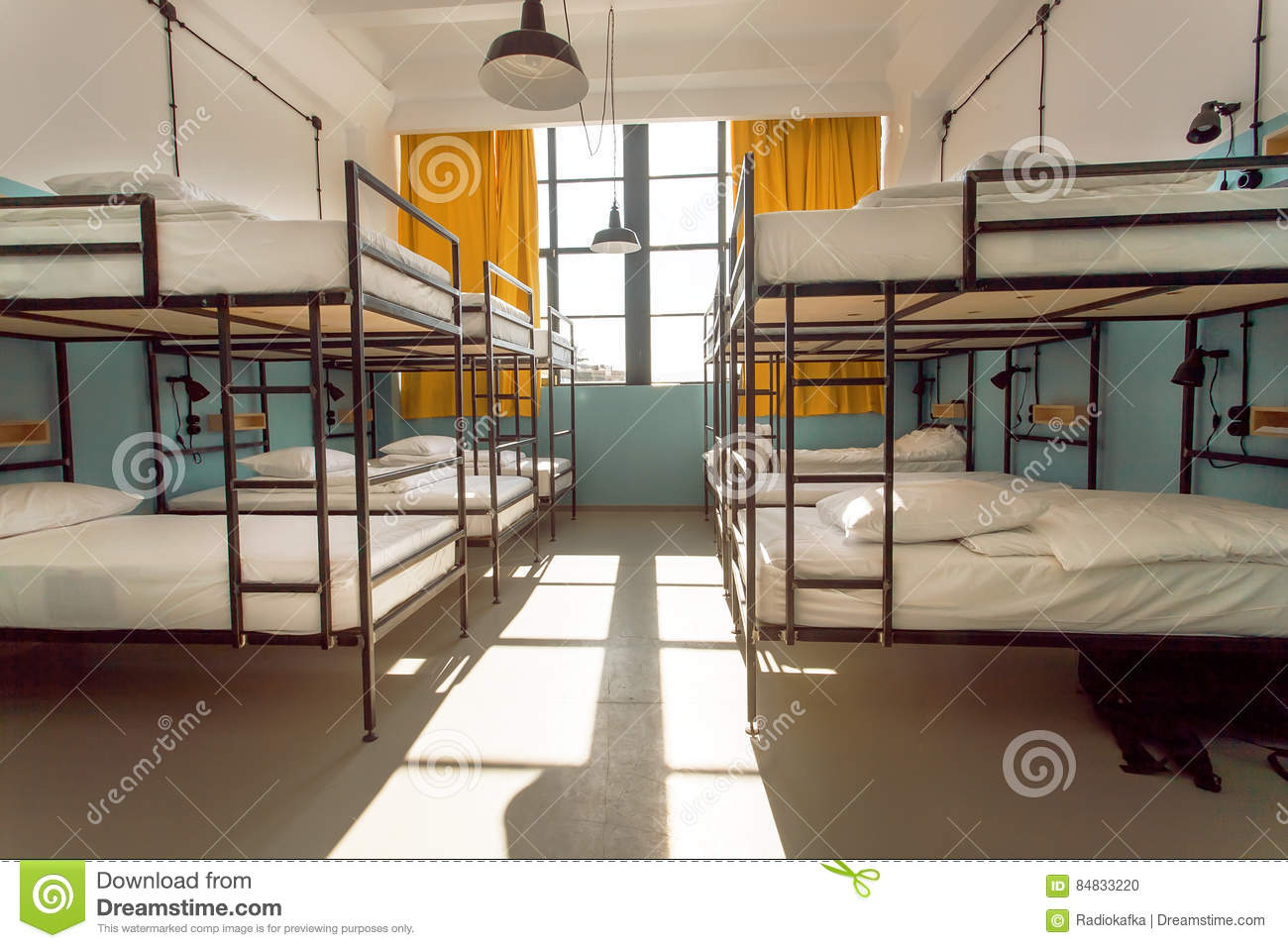 Backpackers stay in hotel with modern double decker beds for Room design double deck