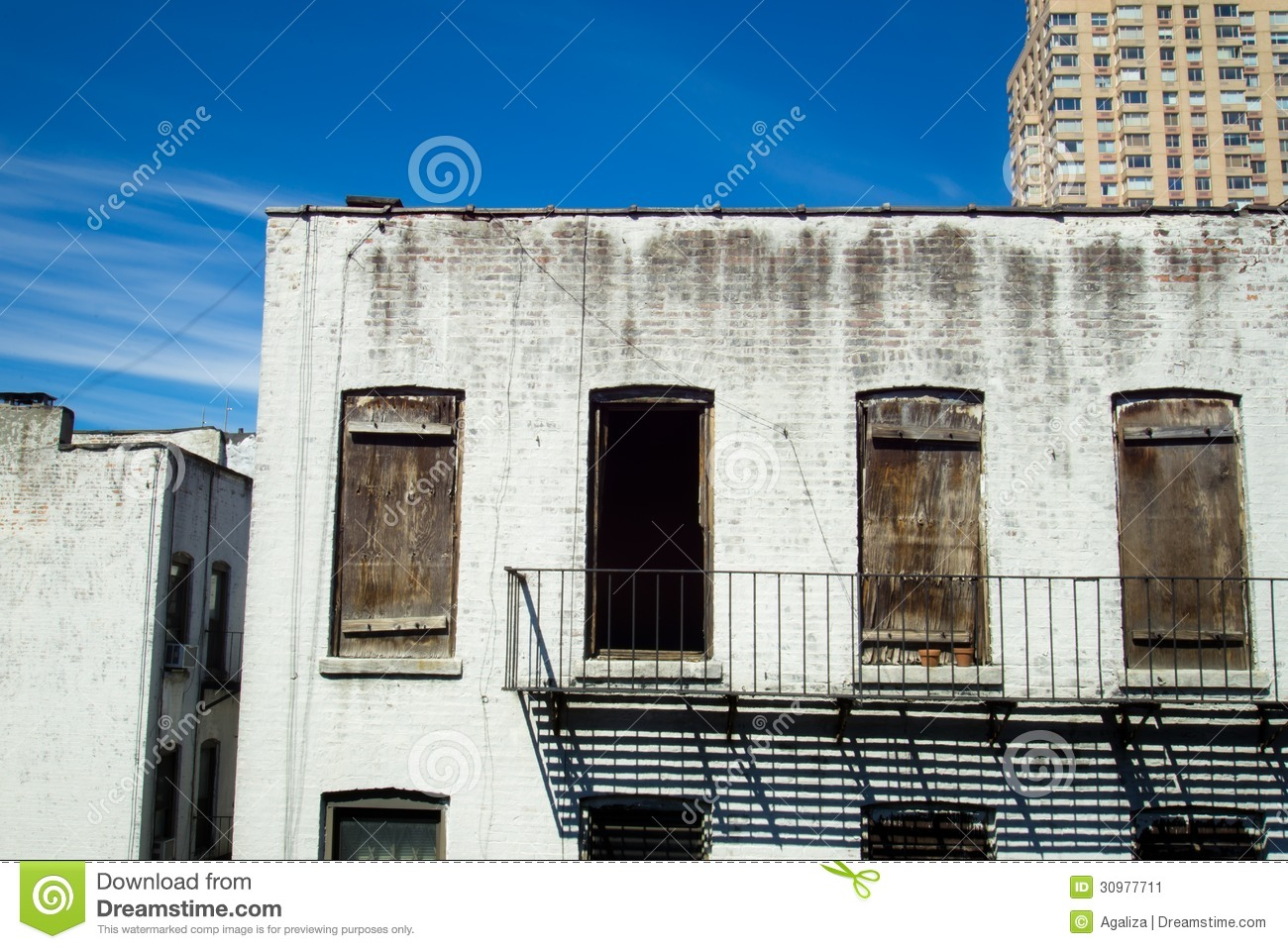 Backside of abandoned brownstone apartment building stock for Floor plans manhattan apartment buildings
