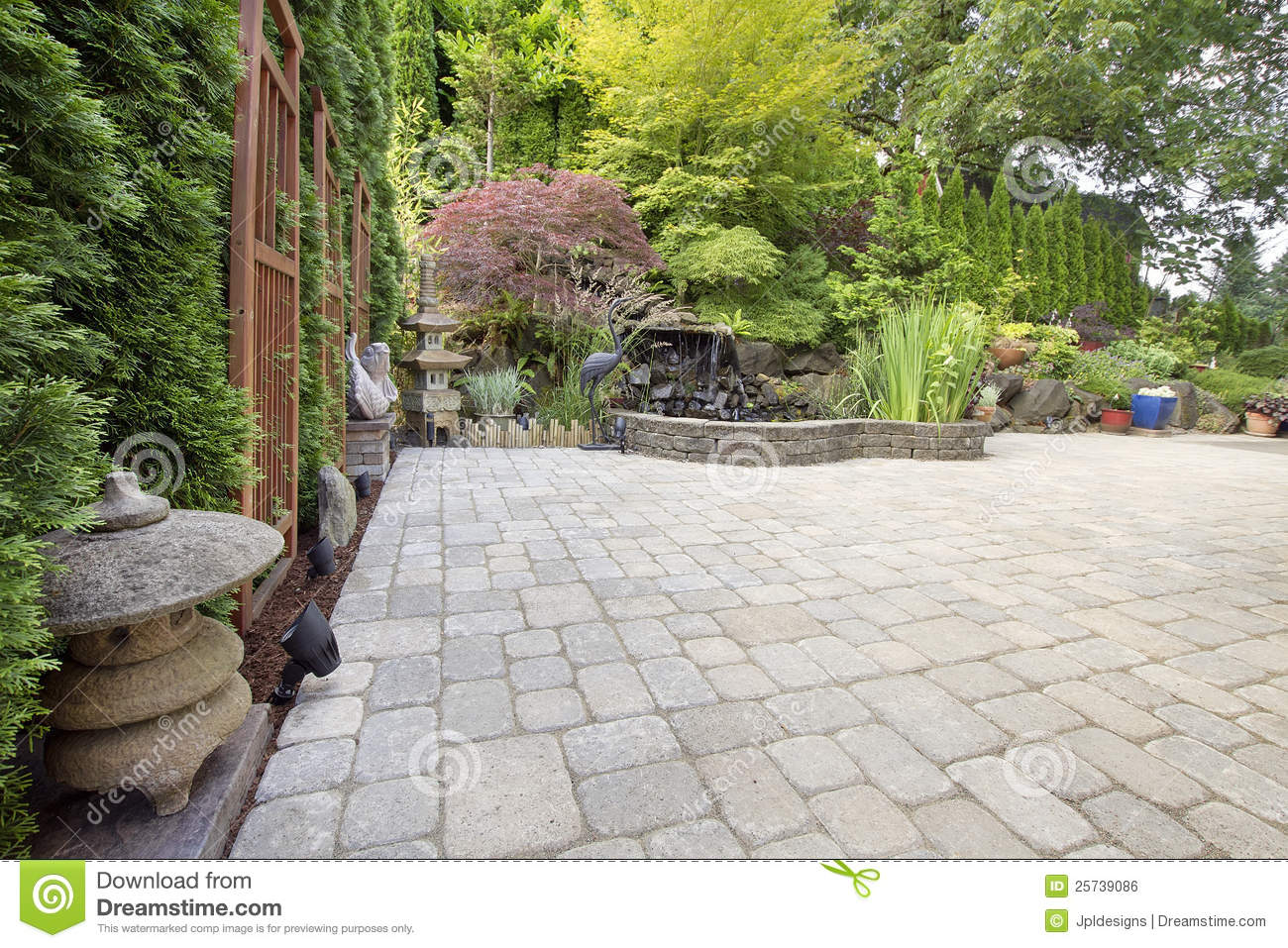 Backyard Asian Inspired Paver Patio Garden Royalty Free