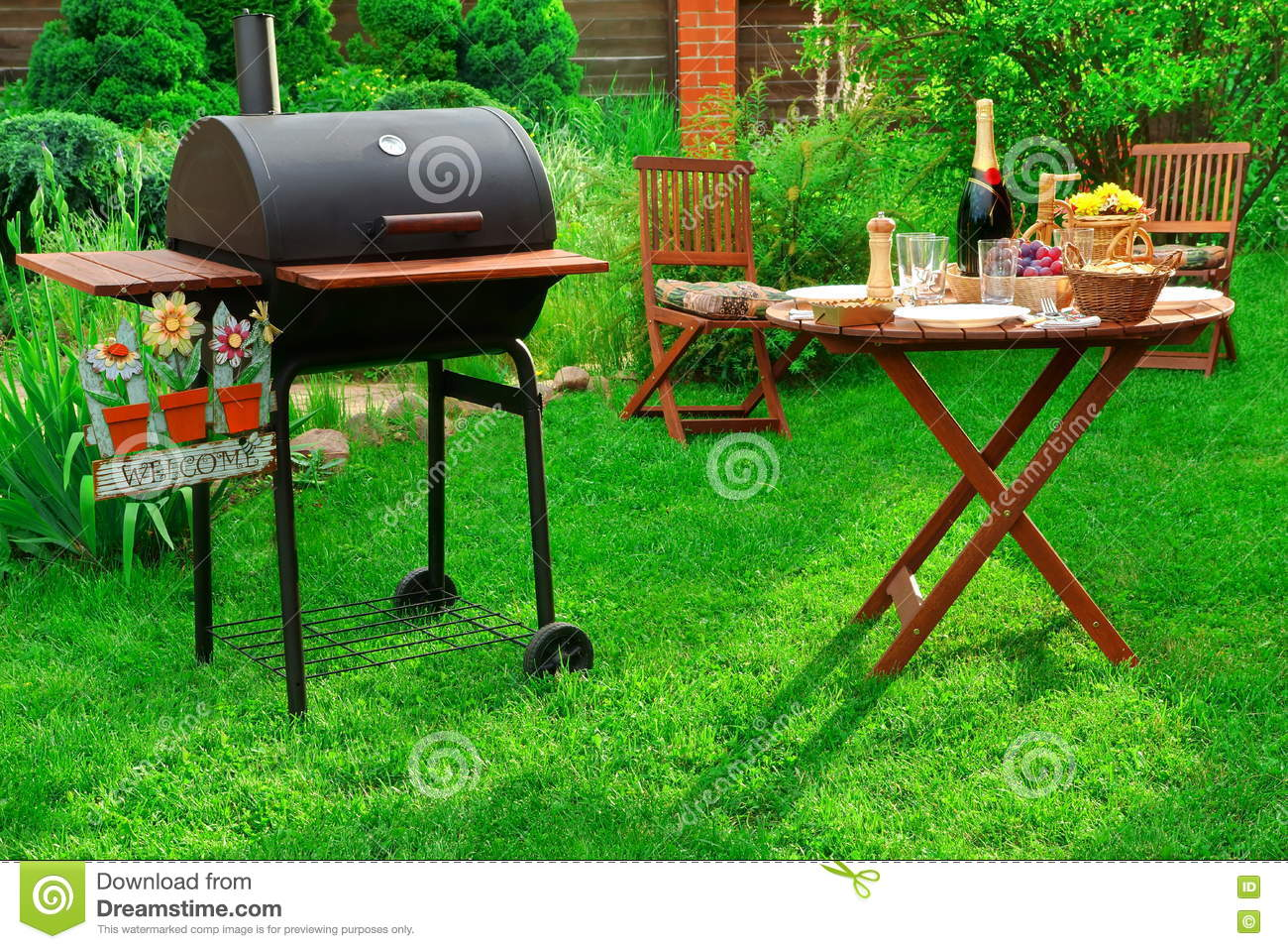 backyard bbq party with charcoal grill wine and served table