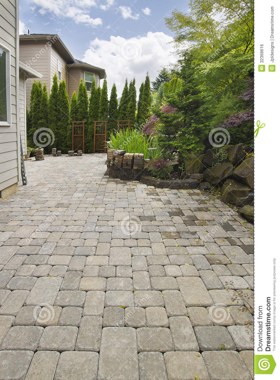backyard brick paver patio with pond royalty free stock image image