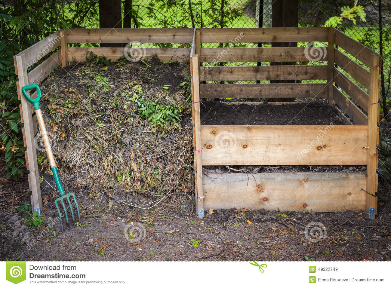 compost boxes with composted soil and yard waste for backyard
