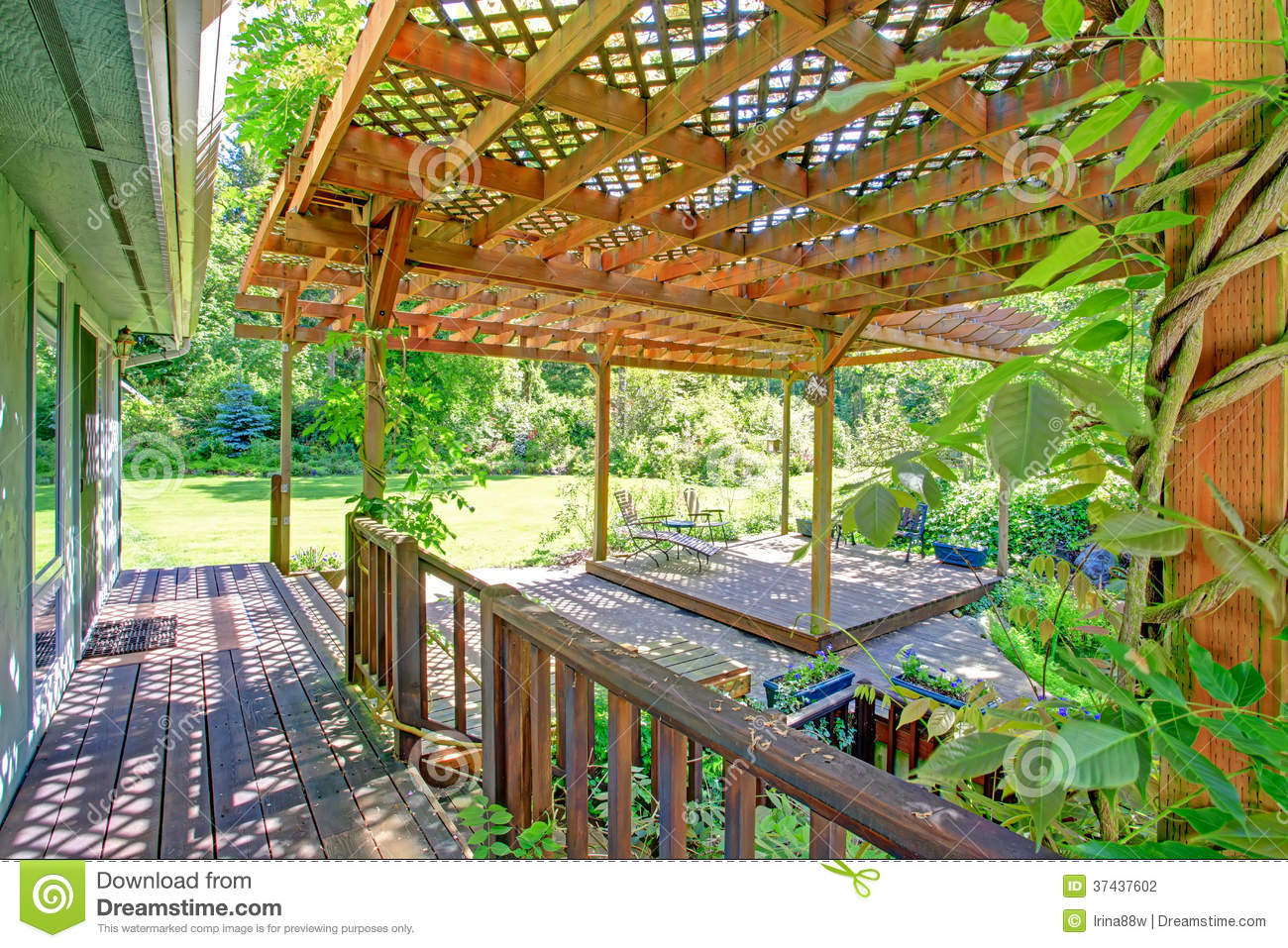 Backyard Farm Deck With Attached Open Pergola Stock Photo