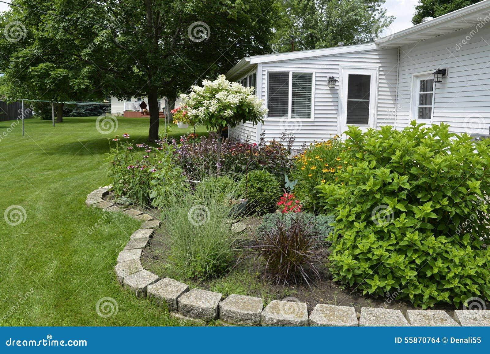 Backyard Flower Garden flowers on patio garden. stock photo - image: 55385209