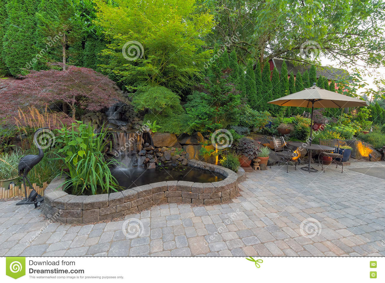 Backyard landscaping patio with waterfall pond stock photo for Garden pond design software free download