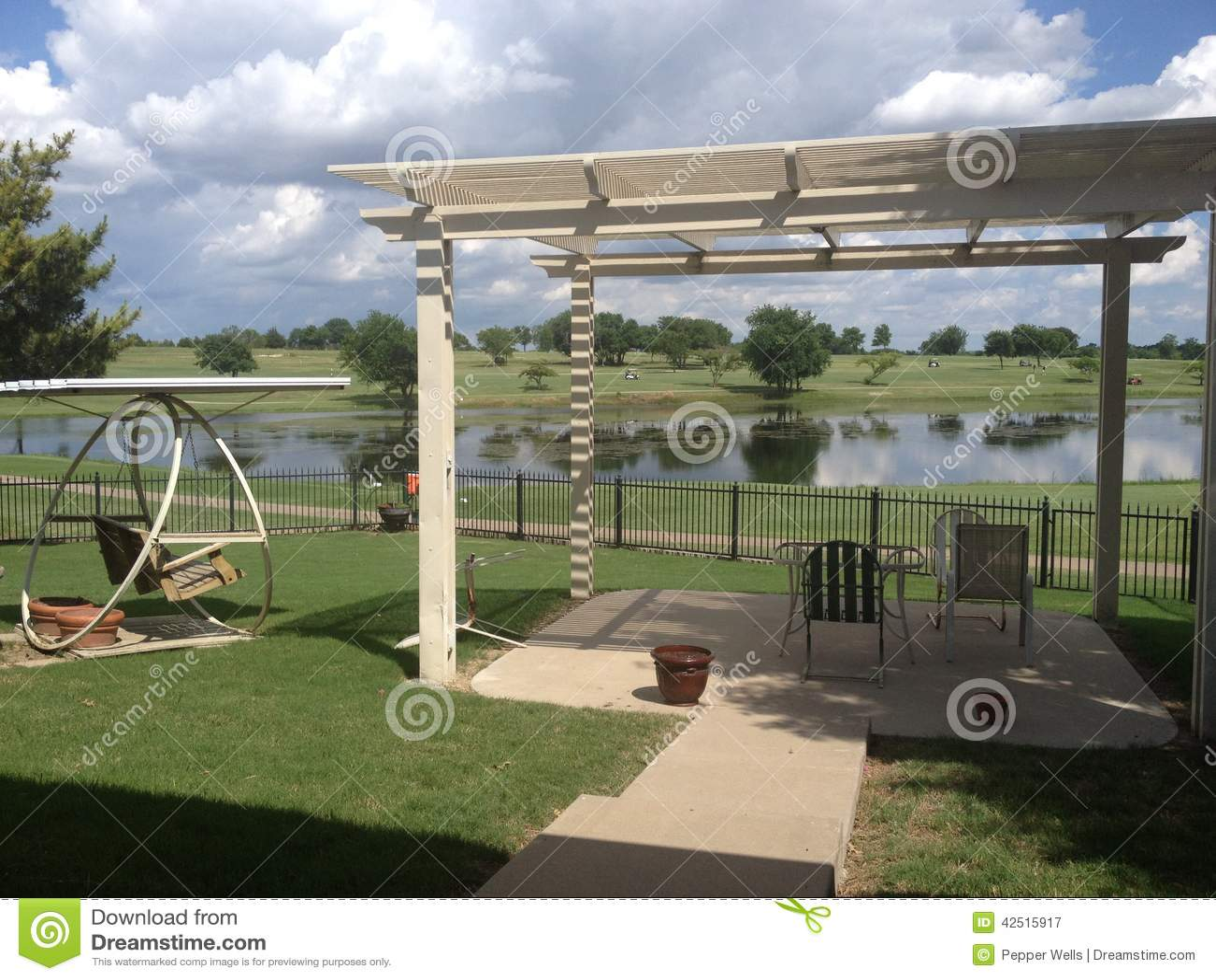 backyard looking across lake at golf course stock photo image